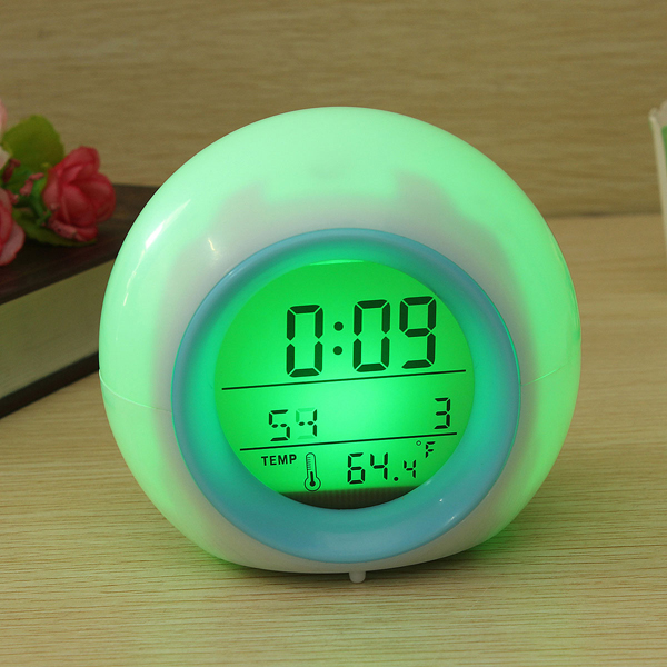 Digital LED 7 Color Changing Alarm Clock Thermometer Nature Sound - EachineCreative Alarm Clocks<br>Description: This alarm clock provides a soft glow in 7 colours. Complete with a clear LCD display which is simple and easy to read. The 7 colour backlight allows you to see the time in the dark. A best gift for you ,your lover,your kids,your family etc. Display Time, Day, Month, Date and Temperature Temperature unit C/F changeable Support 12-hour and 24-hour time format, calendar, alarm and temperature Features &amp; details: Material: Plastic Weight: About 142g Color: As shown in pictures Size: Approx. 10x9.2x9.5cm/ 3.94x3.62x3.74inch Power: 3Pcs AAA Batteries(Not included) Package Included: 1pcs X LCD Digital Alarm Clock Notice: Please allow 1-3mm error due to manual measurement and make sure you do not mind before ordering. Please understand that colors may exist chromatic aberration as the different placement of pictures.<br>