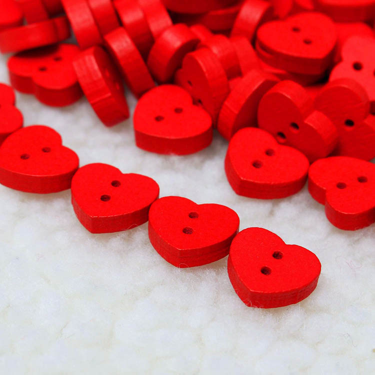 red heart-shape sewing button